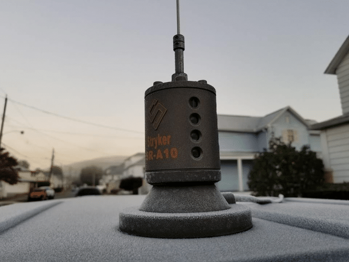 Stryker Sr-A10 magnetic mount ice-covered on the car rooftop on a snowy day.